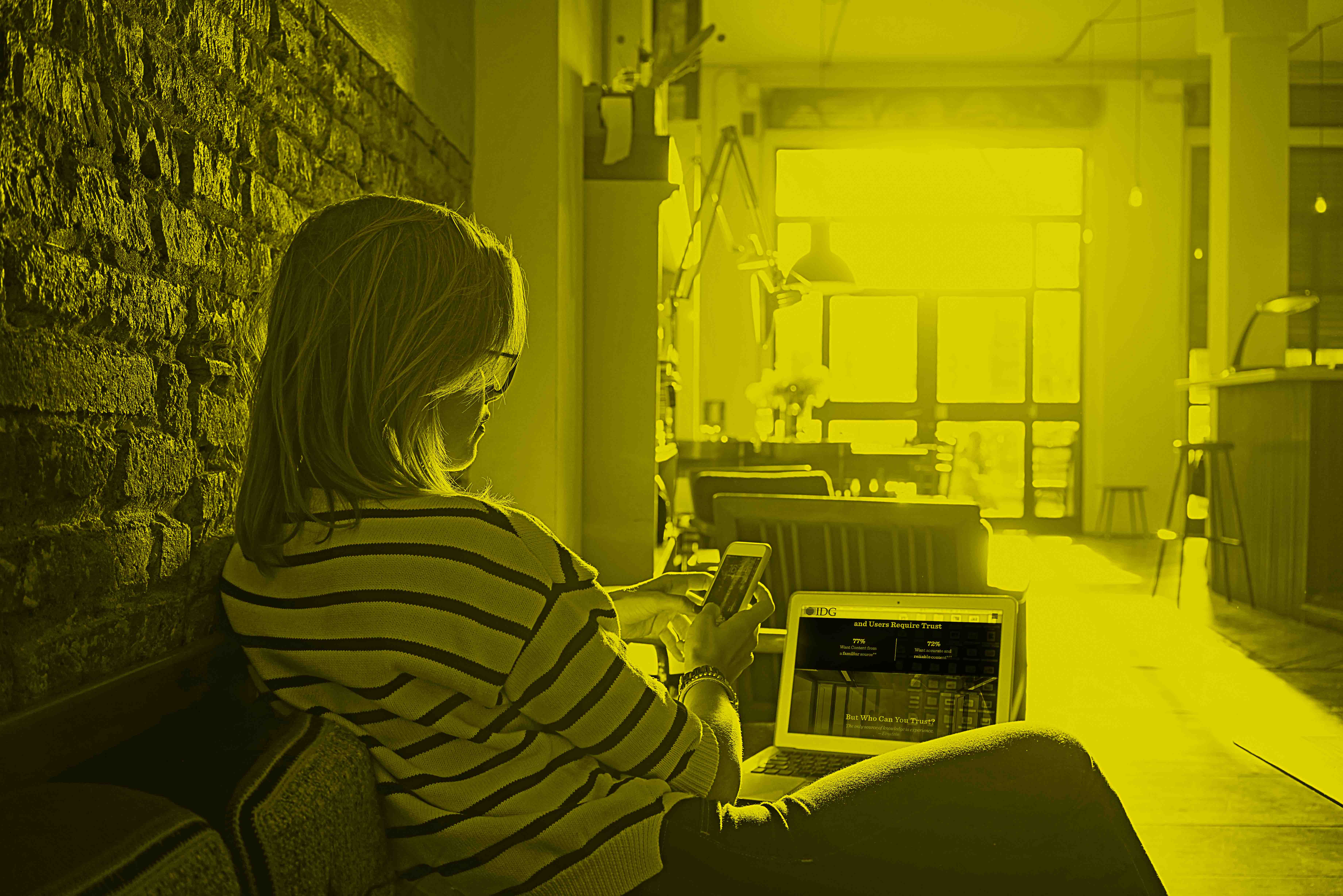 Female Millennial Sitting Laptop Cell _yellow.jpg