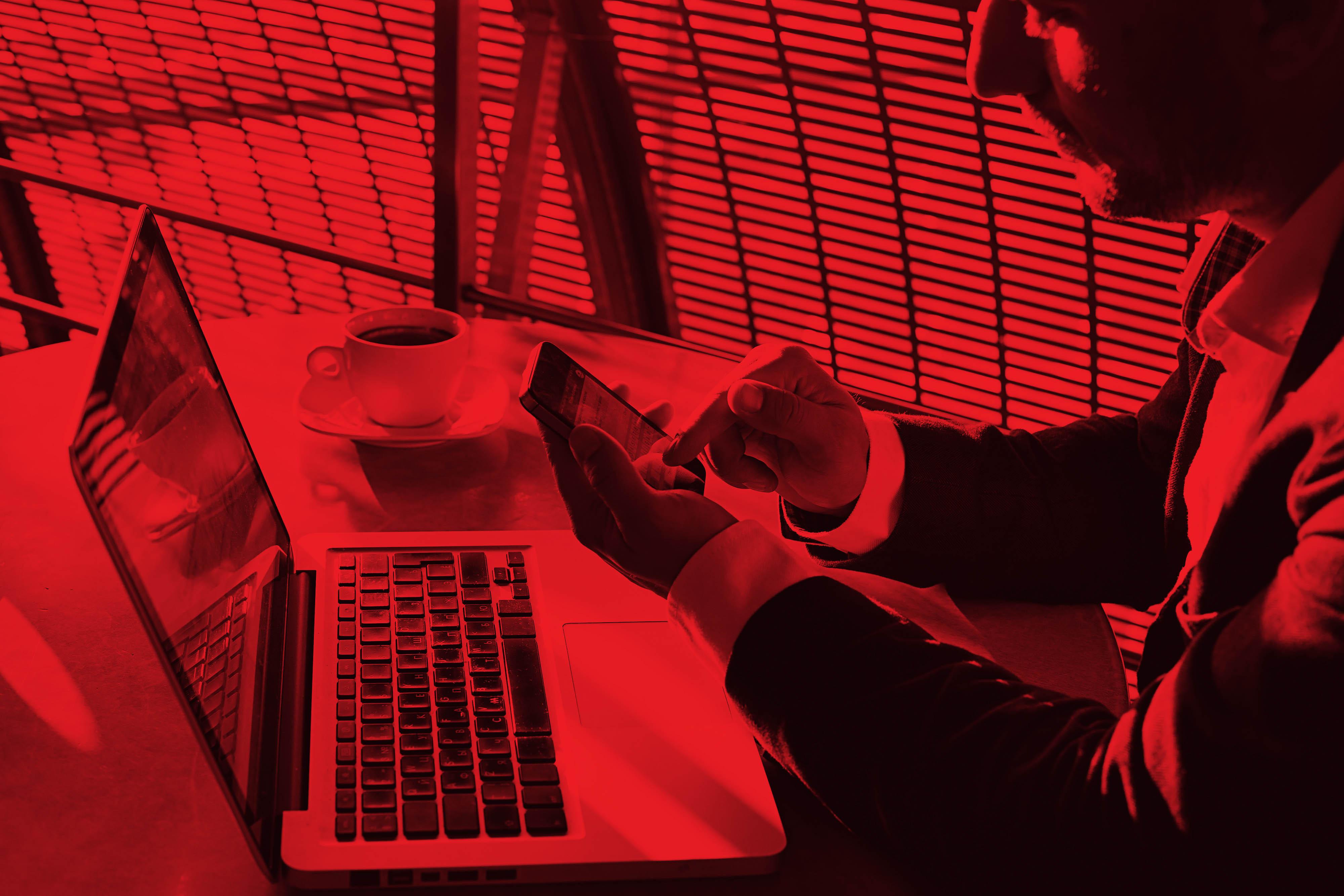 Man_Coffee_Laptop_Cell_Red.jpg