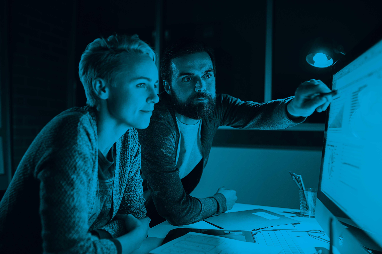 Man_Woman_Looking at Desktop_Blue.jpg