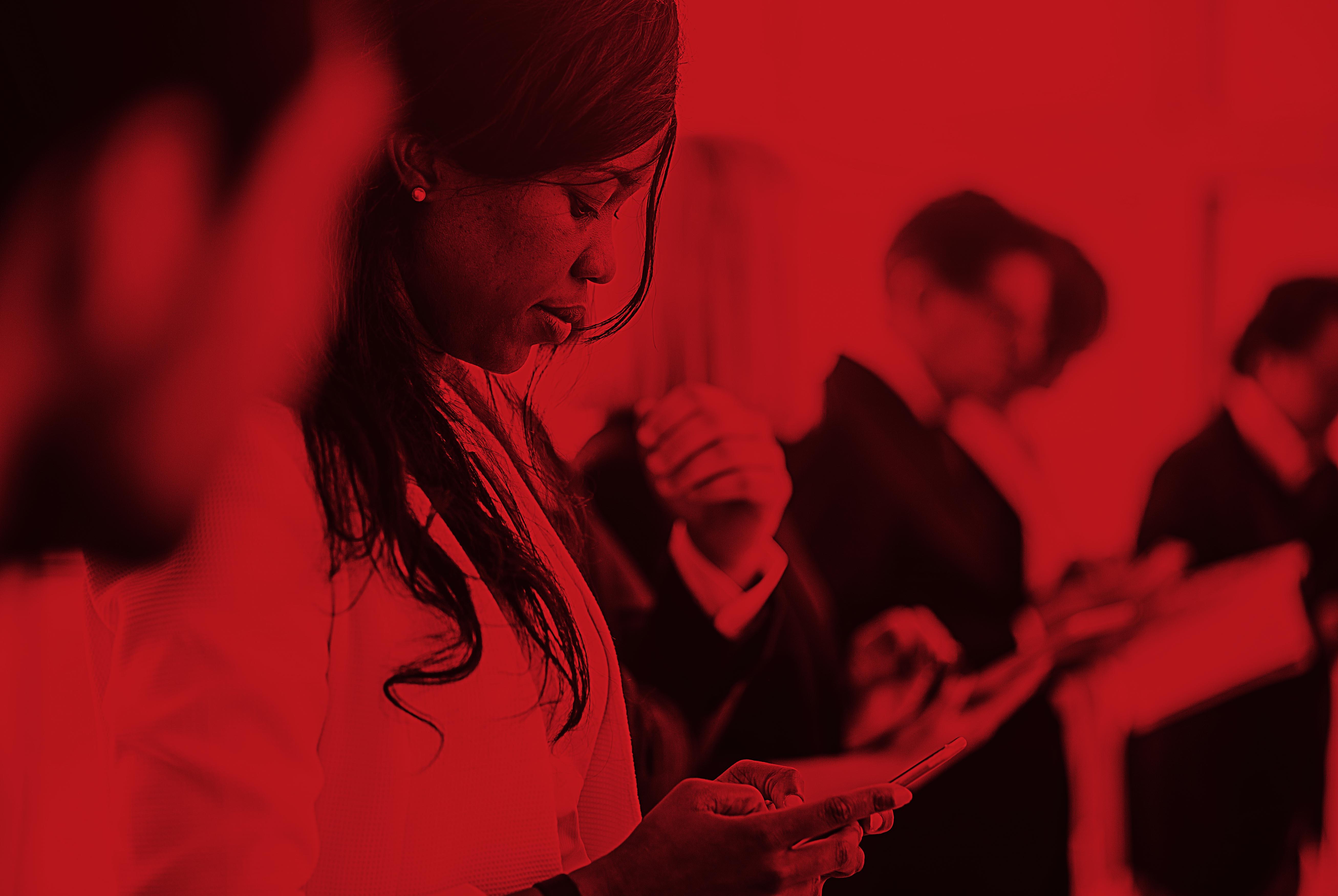 Woman_Looking_Down_Tablet_Side_Red.jpg