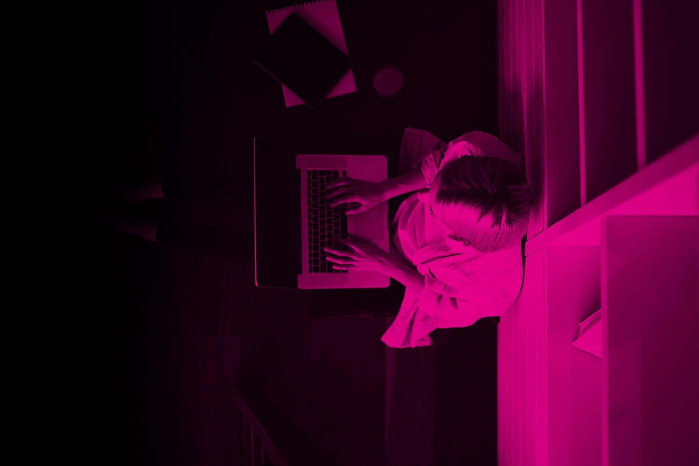 Woman_Sitting_Laptop_in Lap_Pink.jpg
